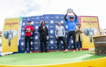 Mick Fanning and John John Florence celebrate on the podium at the JBay Open 2016.